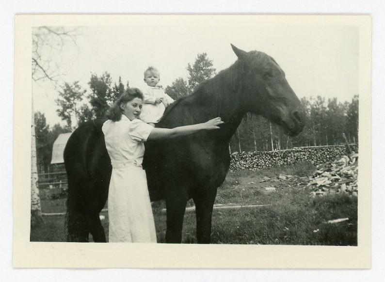 Black and White Photo Mother is the Horseback Teacher 108