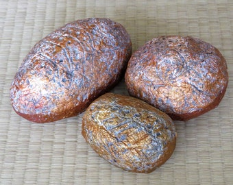 Paper mache pebbles, decorated with fossil like leafs, copper orange and white, metallic color,Mediterranean inspired  , hand sculpted,