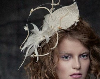 Hat, fascinator, bridal head piece in ivory with floaty detail and feathers
