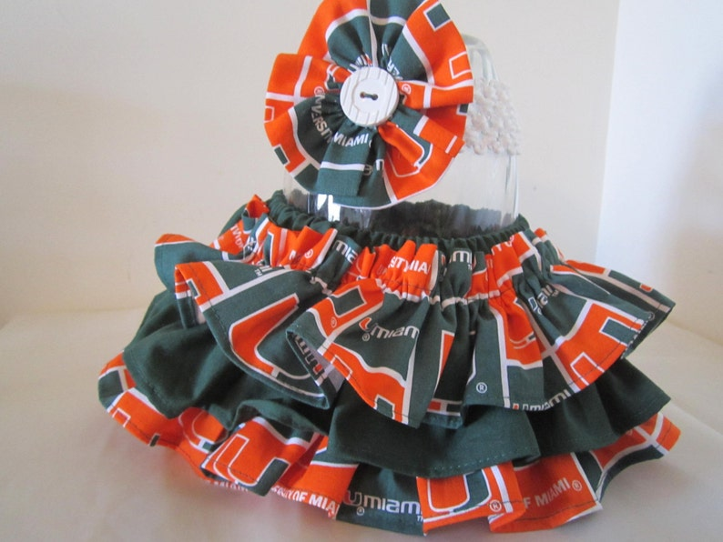 Football girl SALE!University of Miami Colors Ruffle Bloomers Matching Headband girl baby