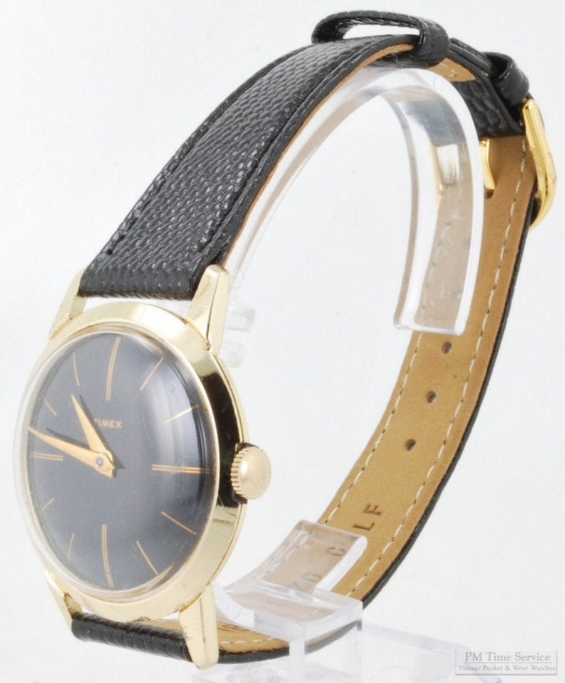 Timex vintage wrist watch 15 jewels gold-toned round case image 0