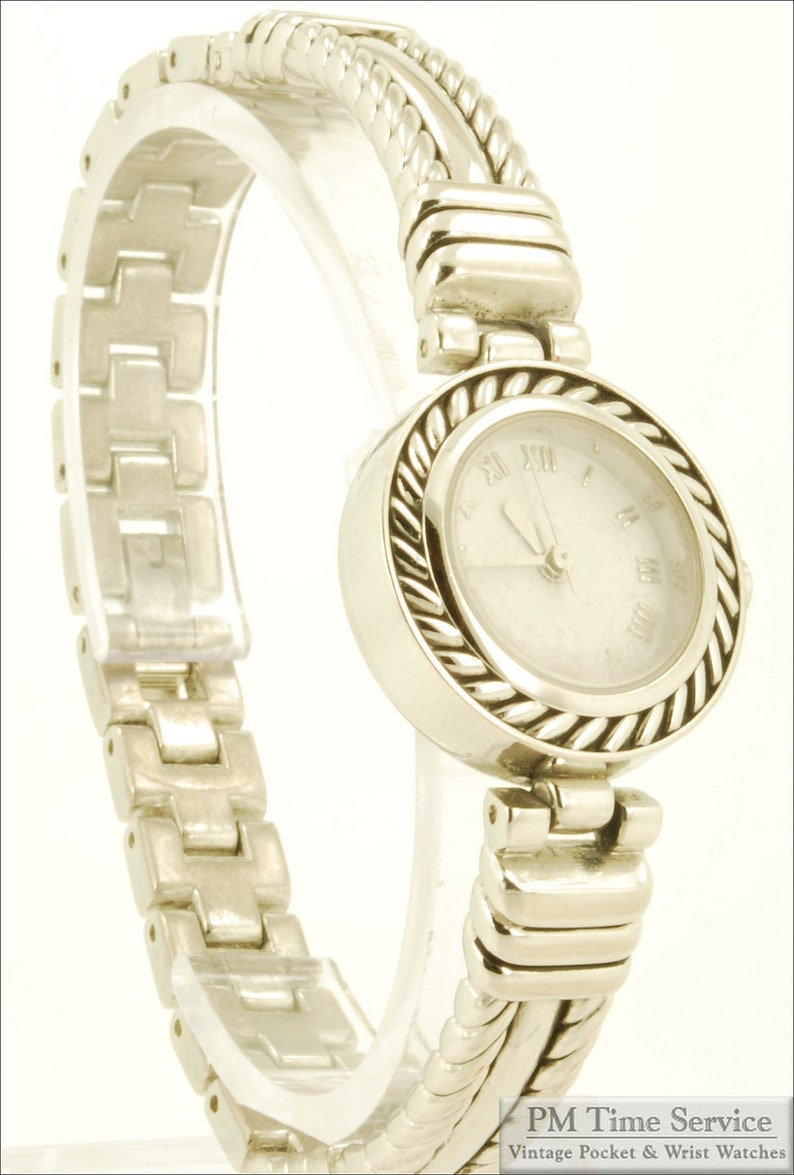 Japanese vintage quartz wrist watch silver-toned & stainless image 0