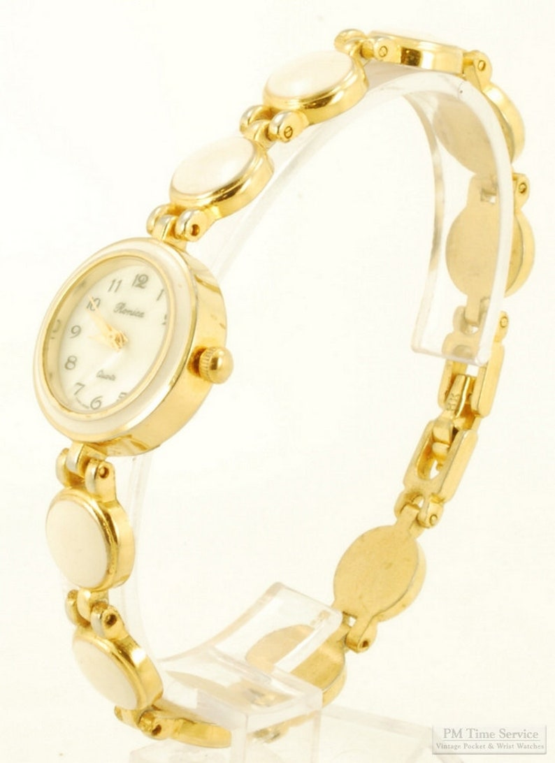 Ronica quartz ladies' wrist watch gold-toned & stainless image 0