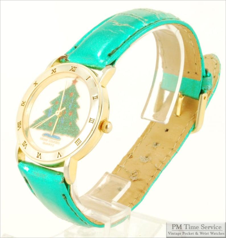 Mane Lourdes quartz vintage wrist watch gold-toned & image 0