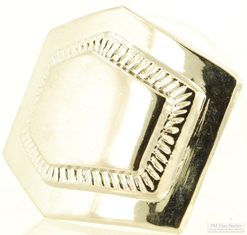 Silver-toned belt buckle asymmetrical 6-sided shape with a image 0