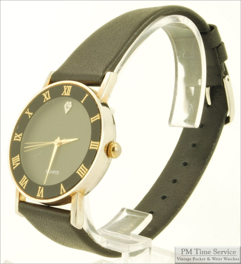 Chinese-made vintage quartz wrist watch gold-toned & image 0