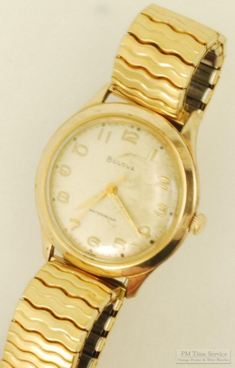 Bulova vintage wrist watch 15 jewels round yellow gold image 0