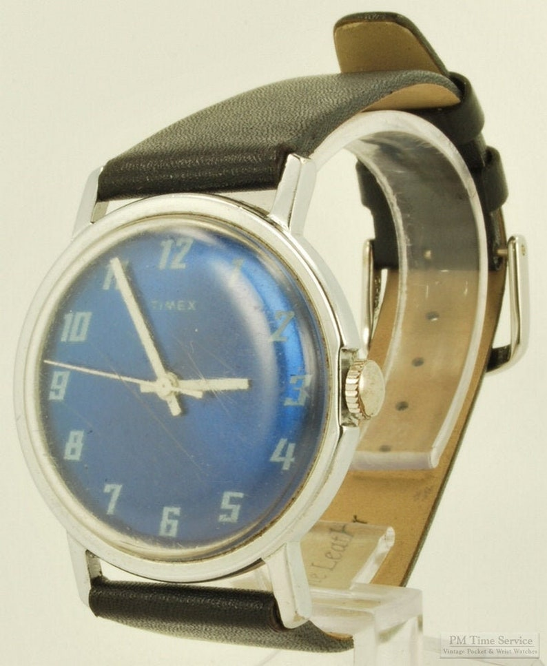 Timex vintage wrist watch 15 jewels silver-toned & stainless image 0