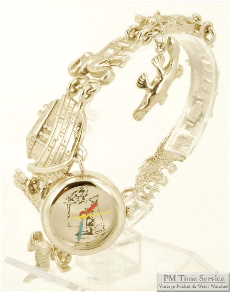 Japanese-movement quartz charm bracelet vintage watch image 0