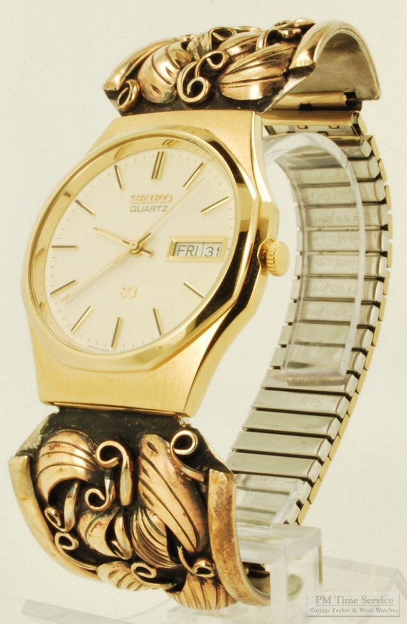 Seiko quartz with day and date wrist watch gold-toned & image 0