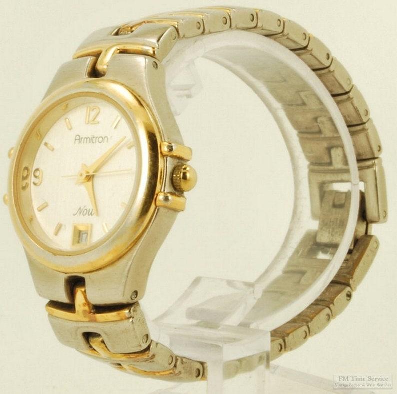 Armitron ladies quartz with date wrist watch yellow gold image 0