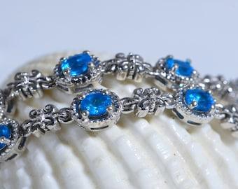 Bracelet aquamarine infinity semi-precious gemstone infinity light pale blue sterling silver .925 15 oval cut stones safety locks