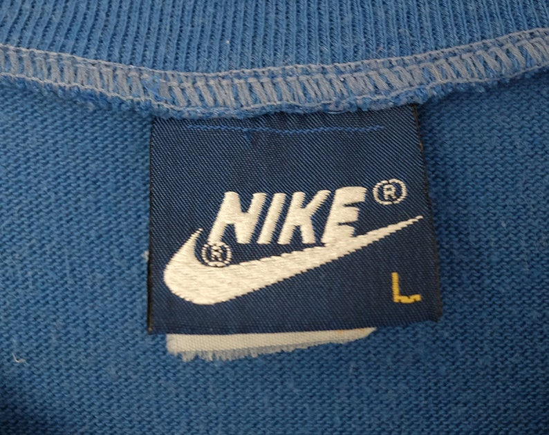 310789dfbb4a0 Vintage Nike Old Swoosh Logo 80's Bright Blue Poly-Cotton Blend Athletic  T-Shirt, Made in USA - Large