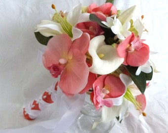 Coral and white Tropical wedding bouquets and matching boutonnieres with calla lilies orchids and lilies