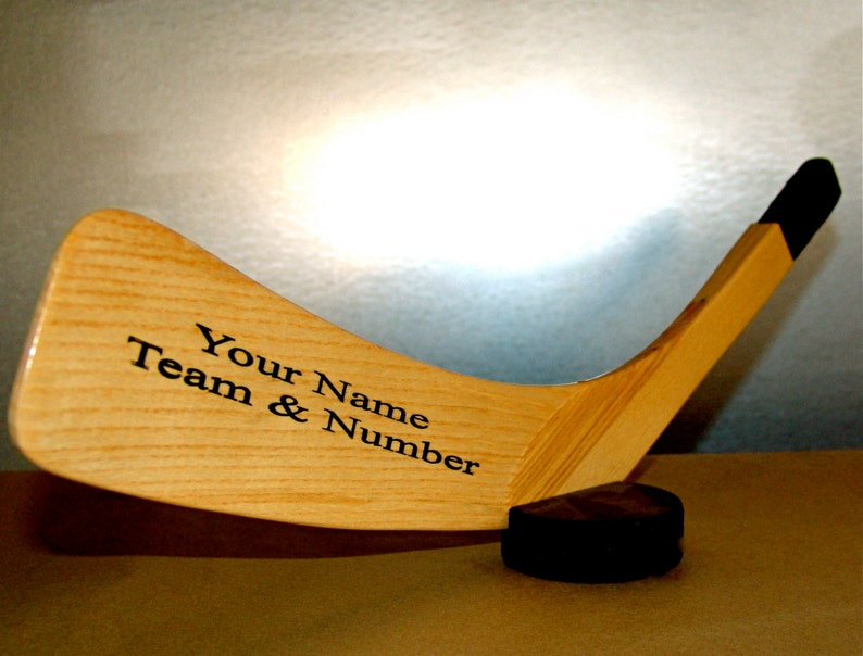 Hockey fan personalized blade with puck holder