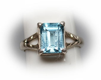 Sterling Silver Two Carat Emerald Sky Blue Topaz  Ring