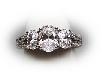 Sterling Silver Oval Cut CZ Three Stone Engagment Ring
