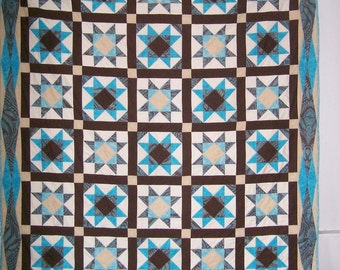 Queen size Ohio star quilt with turquoise, brown and cream