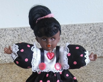 Black African American doll, with matching tote bag