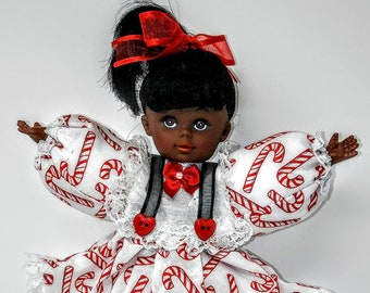 Black African American doll and Candy Land game