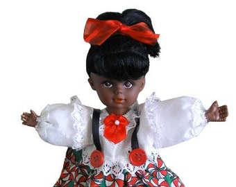 Black African American doll, with candy tin.
