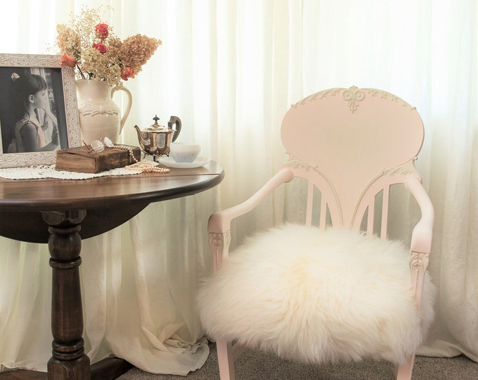 Featured listing image: Pink vintage chair with sheepskin