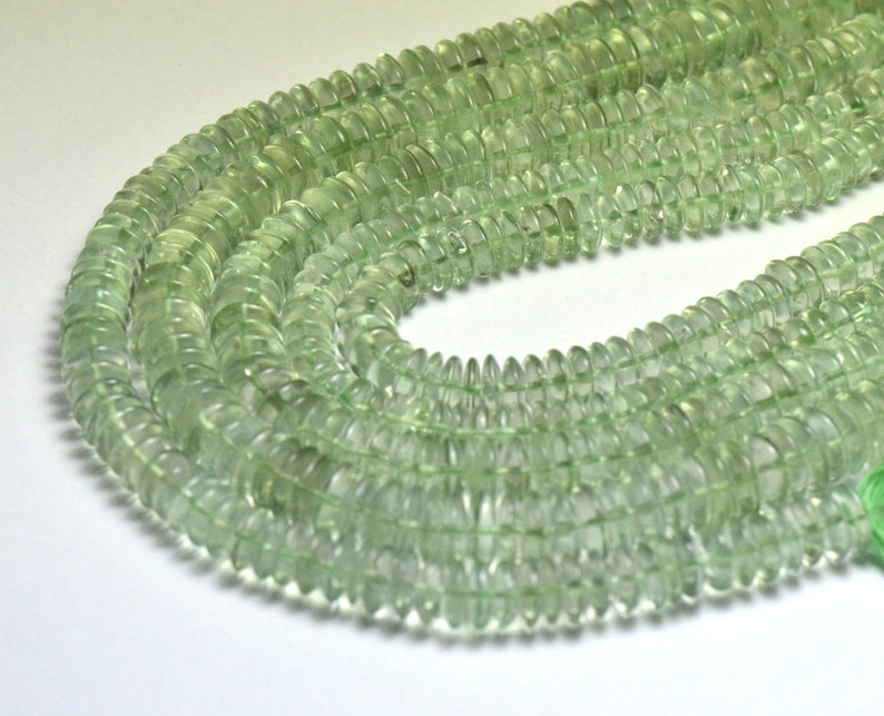we suggest using 0.010in 0.25mm wire 7mm to 8mm 10 AAA Green Amethyst smooth roundelle beads AMG002