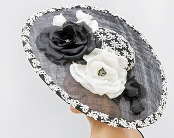 made with passion this big black and off white  saucer hat with ton sur ton flowers on comb