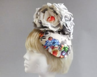 Dutch design percher hat ;  sinamay base covered with multicolour fabric and ton sur ton handmade flowers on comb