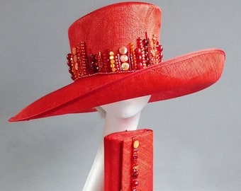 made with passion this red sinamay derby hat size 57,5 or 22,7 inch with many many beads in red and orange with matching bag
