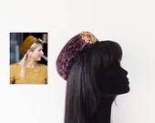 Dutch design aubergine astrakhan pillbox hat with vintage brooch on comb