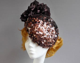 Made with passion Dutch design brown and copper percer hat with sequins and flowers on comb