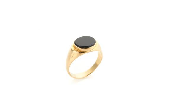 bague or pierre noire homme