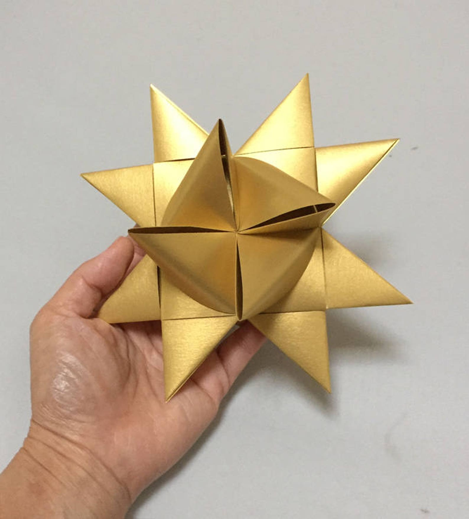 Large Moravian Stars: 5.5 to 6 inches in size, Metallic Gold in Color. Sold individually