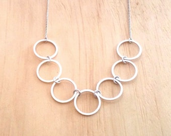 Small Simple Silver Seven Circle Statement Necklace
