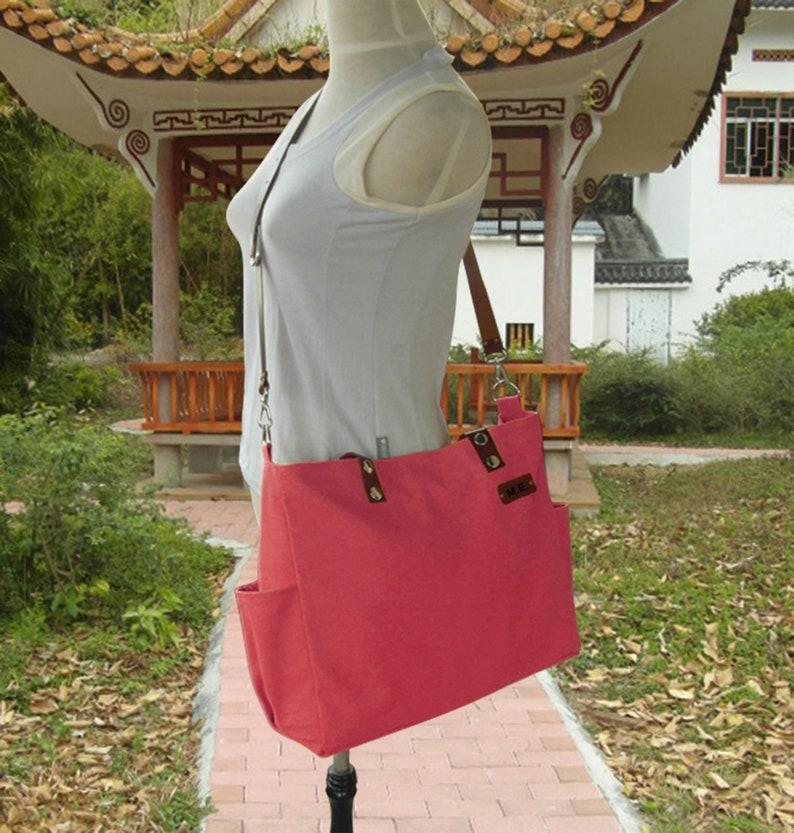 Red canvas messenger bag leather straps women tote bag men image 0