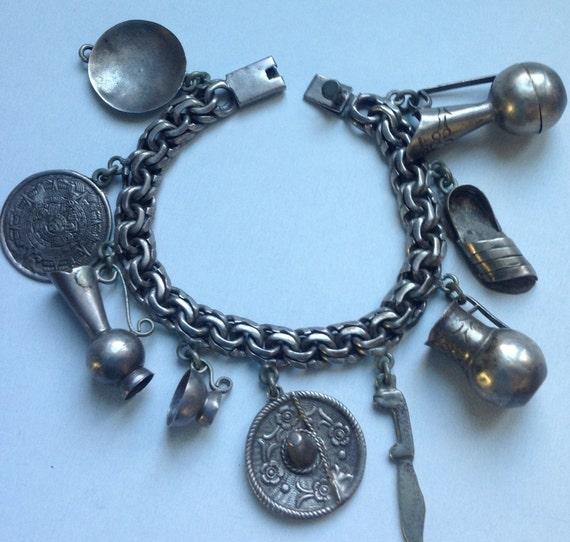 Vintage Mexican Sterling Charm bracelet signed   V