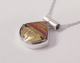 Hand crafted Dichroic glass, gold and sterling silver pendant.
