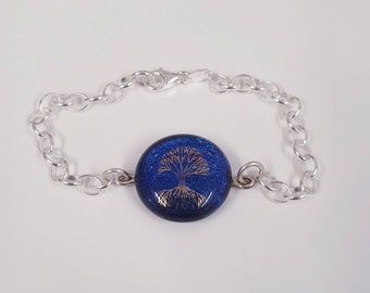 Dichroic glass bracelet with tree of life image and a unique extra of a magnet set in the back.