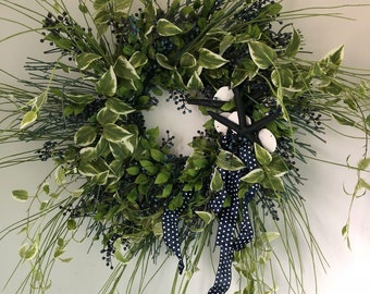 Beach weath with navy blue real starfish and white sand dollars. Wedding wreath with navy blue polka dots.