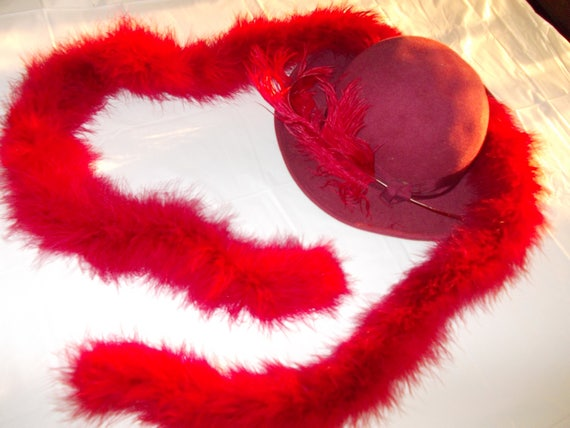 Burgandy hat with feather and matching boa