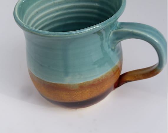 Pottery mug in blues and gold,