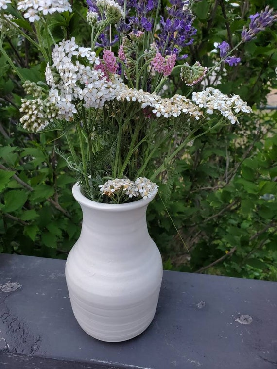 Pottery Vase in white eight inches high