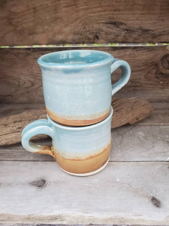 Pottery pair of mugs in blues and gold, tea, coffee, for Rebecca hold 10 ounces each free local pick up!