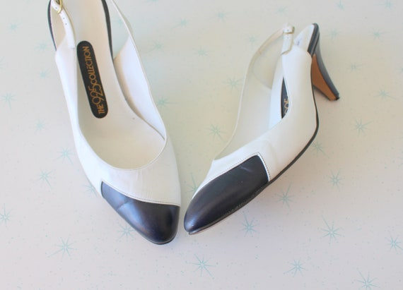 1960s BLACK and WHITE Heels....size 9...kitten hee