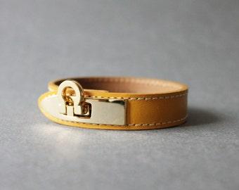 Gancini Metal Ornament Bracelet (Mustard)