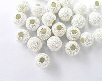 20 of 925 Sterling Silver Stardust Beads 4 mm. :th0790