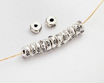 20 of Karen Hill Tribe Silver Daisy Imprint Beads 4x2 mm. :ka2392