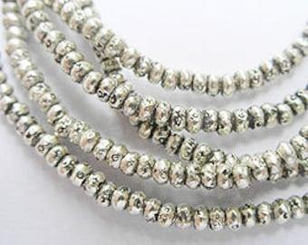220 of Karen Hill Tribe Silver Imprint Seed Beads 2x1.5 mm. :ka1003