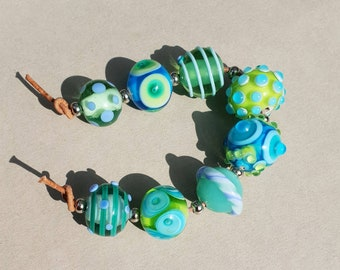 Summerbeads in blues and greens by Flamejewels.